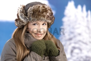 Young woman dressed up warm freezing smiling