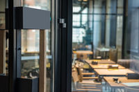 Restaurant door handle with pull sign on glass doors