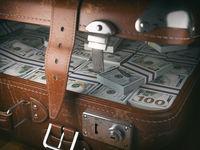 Vintage suitcase full of money. Business emigration concept background.