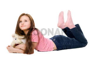 Little girl with a teddy elephant. Isolated
