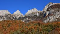 Bright colored forest and peaks of the Churfirsten Range. Autumn scene in St Gallen canton, Switzerland.