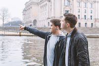 two male tourists exploring government district in Berlin Germany