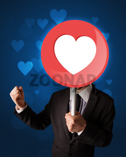 Businessman holding heart sign
