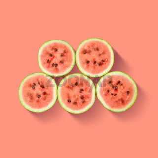 Watermelon slices isolated on pink background.