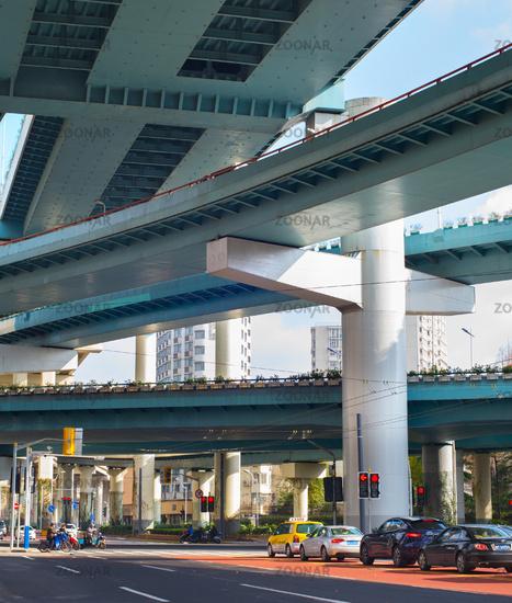 Shanghai traffic under flyover, China