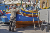 Fishermen Working On Their Boat, Marsaxlokk Village, Malta