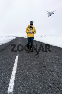 Guy with drone on country roadway