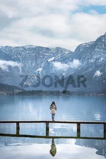 Woman on bridge in alpine scenery