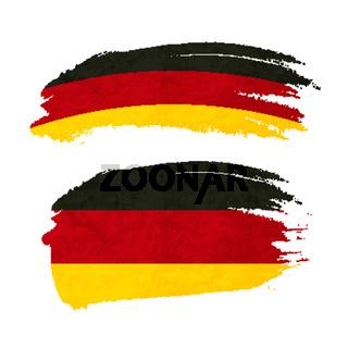Grunge brush stroke with Germany national flag on white