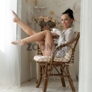 woman is drinking tea in the morning