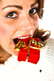Cute Young Woman Holding A Small Present In Her Mouth