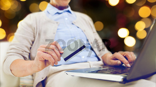 senior woman with laptop and credit card