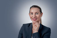 Businesswoman portrait against grey background
