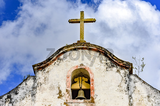 Bell and crucifix on top of old chapel