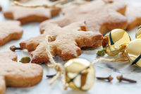 Gingerbread Christmas toys and golden bells close-up.
