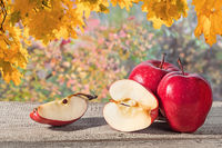 Several apples on a wooden table
