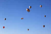 Blurred view on multicolor hot air balloons on blue clear sky