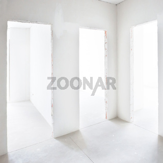 Three doors in white room