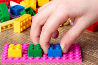 Child playing with toy bricks