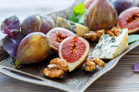 Walnuts, ripe figs and blue cheese on the tray.
