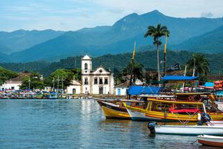 Rio de Janeiro, Brazil - February 15, 2016: Tourist boats waiting for tourists near the Church Igreja de Santa Rita de Cassia in Paraty, state Rio de Janeiro