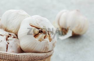 Garlic on concrete floor.