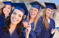 Happy Graduating Group of Girls In Cap and Gown Celebrating on Campus.