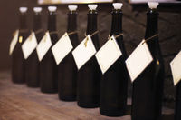 Wine bottles in the row on wooden table