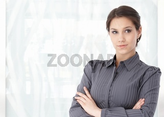 Portrait of young caucasian woman in office lobby