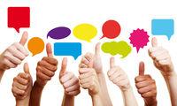 Erfolg bei Kommunikation mit Daumen hoch