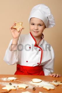 Little cook girl tasting cookies