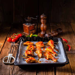 Rustic backed chicken wings,legs on baking tray