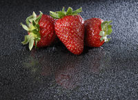 Strawberies over black