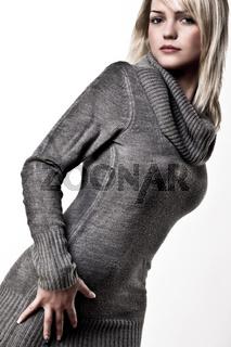 Beautiful Blond Girl Posing In A Big Collar Autumn Sweater