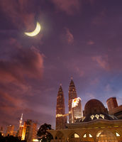Night view of famous Asy-Syakirin Mosque with Petronas Towers