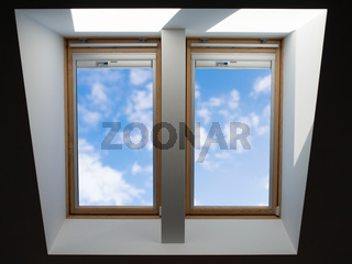 roof windows overlooking the blue slightly cloudy sky