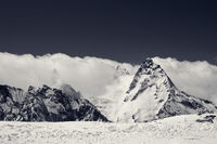 Black and white snowy mountains at sun day