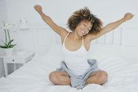 Content woman awaking in morning