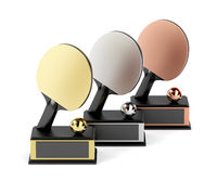 Table tennis trophies on white background