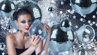 Young attractive woman with disco balls night club portrait