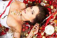 Beautiful brunette lying among Christma decoration