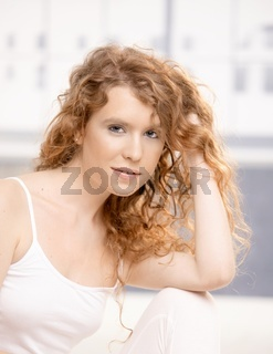 Attractive female sitting on floor in studio