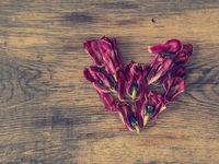 Pink petals  heart shape on wood