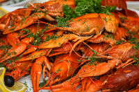 boiled crayfish with herbs and lemon