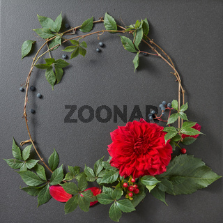 round frame of branches and flower