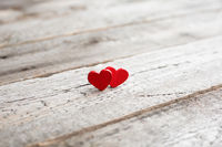 Small red hearts on wood
