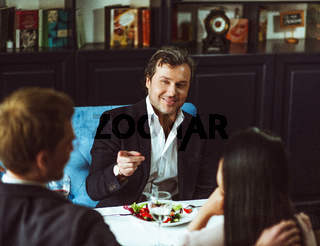 Businesspeople having business lunch