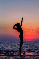 Dance at sunset. Vertical image