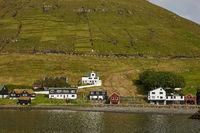 Village in wild and beautiful landscape of Faroe Islands, Denmark