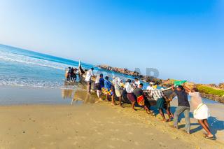 Kovalam Villagers Pushing Fishing Boat Sand Ocean